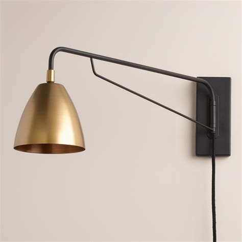 bedroom wall sconce crafted with a pivoting arm and adjustable antique brass