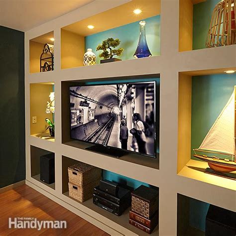 tell you how to build an entertainment wall unit share showcase built in bookcase plans the family handyman