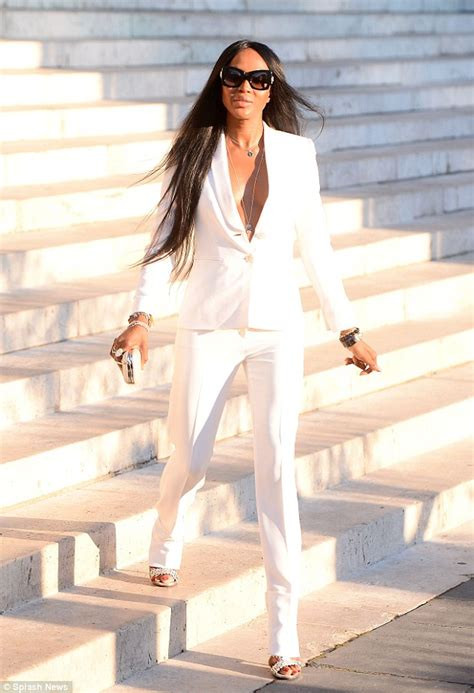 Got Not One But Two White Versace Snap Out Of It Bags by Cbell Braless In Plunging White Suit At Versace