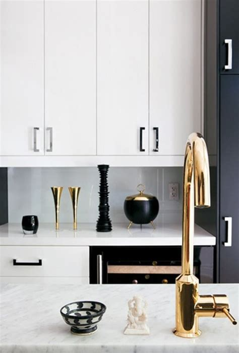 white kitchen cabinets with brass hardware and black black white kitchen brass faucet gold in the kitchen