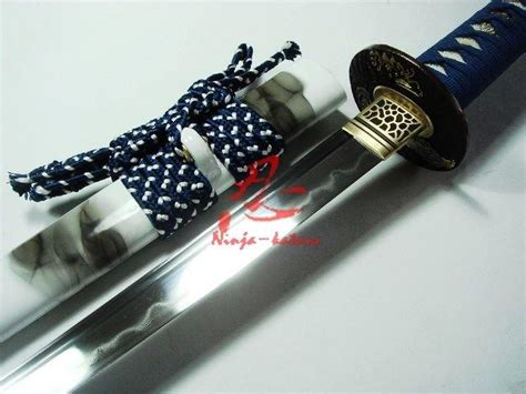sharpen tanto blade battle ready japanese white katana eagle tsuba clay