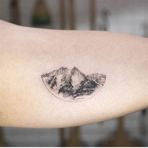 tattoo one needle single needle mountain range tattoo on the left inner arm
