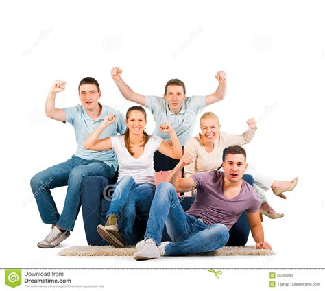 people sitting on a couch young people sitting on a sofa cheering stock photo