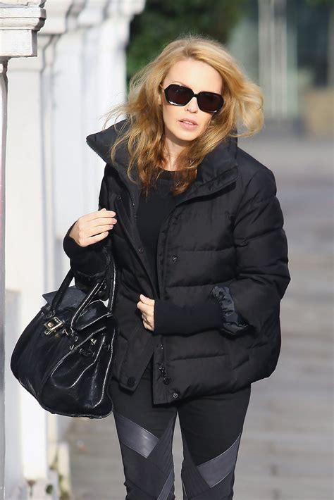 celebrity pink winter jacket kylie minogue down jacket lookbook stylebistro