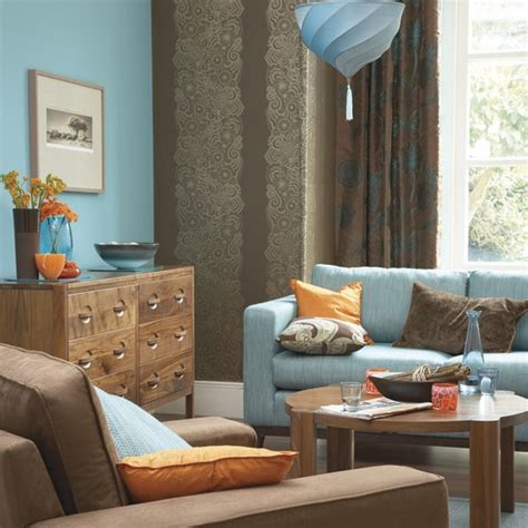 Blue And Brown Color Scheme For Living Room by Bold Blue And Orange Living Room Decorating With