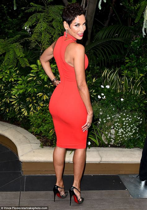 womens clothin for 49 year olds nicole murphy wears cleavage baring red dress for luncheon