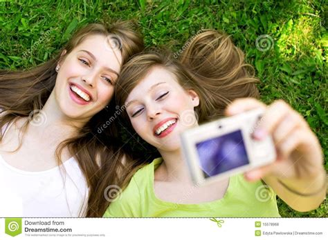 two friends taking pictures stock photo image 15578968