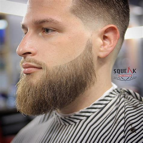 men taper on the sides with beard low fade vs high fade haircuts