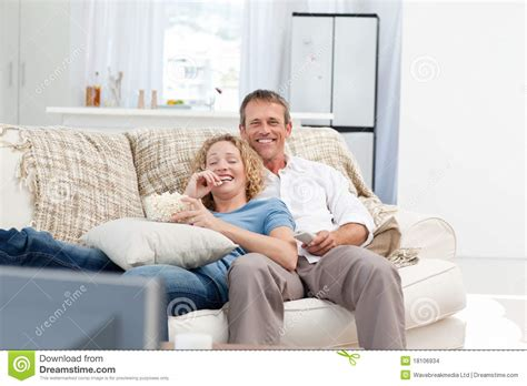 home lovers lovers watching tv in the living room stock images image