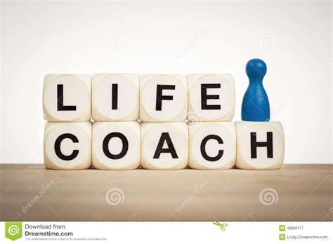 life couch blue pawn next to word life coach spelled by toy dice