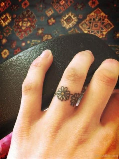 small flower finger tattoos 40 ring finger tattoos