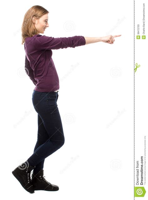 standing sideways smiling happy pointing forwards stock photos