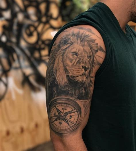 tattoo arm lion compass tattoo designs with meaning nautical compass