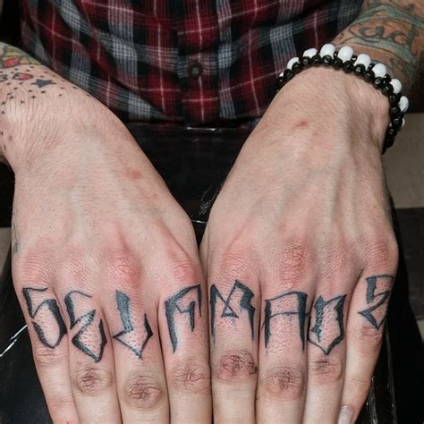 knuckle tattoos 50 strong knuckle designs ideas for brave