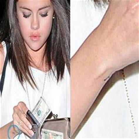 selena gomez tattoo on her wrist tattoos on tiny tattoos and