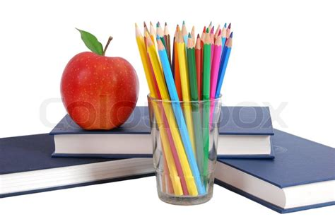 apple picture books apple and colored pencil on books stock photo