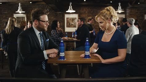 bud light party box amy schumer and seth rogen banter about equal pay in new
