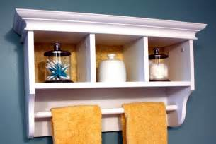 Small white bathroom shelf ideas on blue wall paint plus nice towel