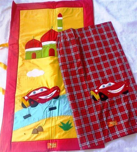 Sarung Anak Cars Size L detail baju koko cenderawasih kuning toko bunda
