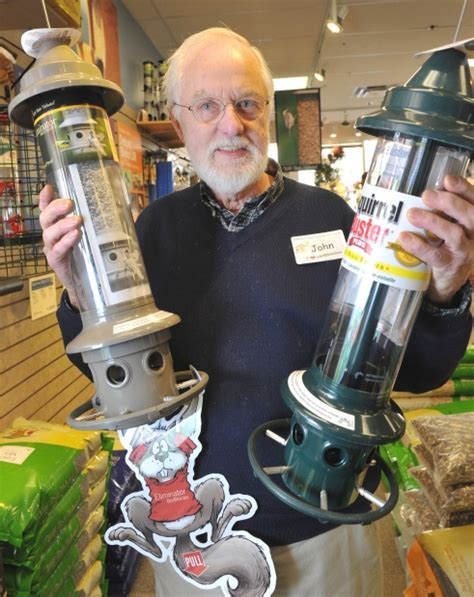 john morton shows off the squirrel proof bird feeder at
