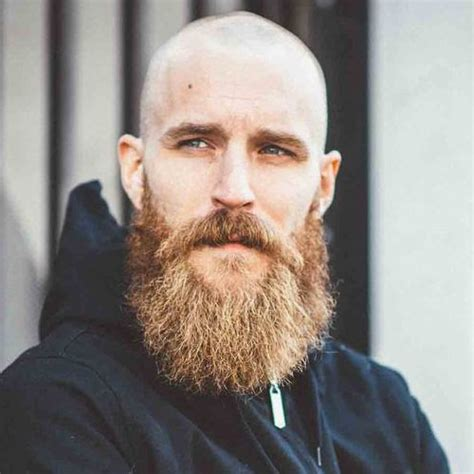 bold man with big eres 5 reasons to go bald with a beard