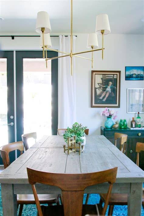 dining area features gray farmhouse table gold light