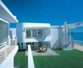 Beach Houses Modern Beach House With White Exterior Paint By Richard