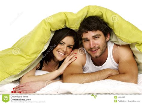 beautiful in bed a green duvet royalty free