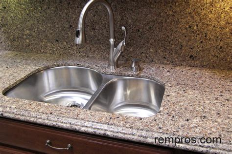 Quartz kitchen countertop with quartz backsplash and
