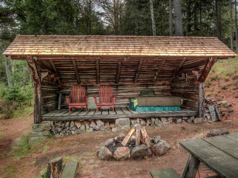 Cheap Hunting Cabin Ideas by Rustic Landscape And Yard With Wrap Around Porch Amp Fire