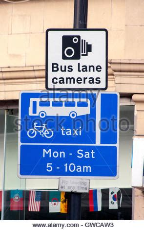 bus taxi cycle lane sign on a main road when they share
