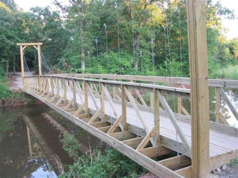 Diy Build A Suspension Footbridge These Friends Dragged Wood Near The River To Make The Most