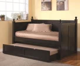 Wooden Frame Daybed With Trundle Black Wooden Daybed With Trundle And Soft Brown Cover