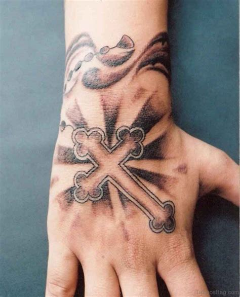 hand and cross tattoo 30 superb cross tattoos on