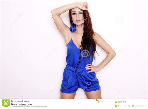 who is the brunette in the blue dress in the viagra add brunette posing in blue dress royalty free stock photos