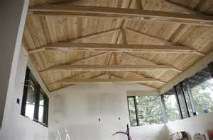 tongue and groove cedar ceiling painted black beams with white tongue and groove and
