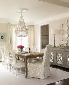 Gray Mirrored Sideboard Under Decorative Wall Plates