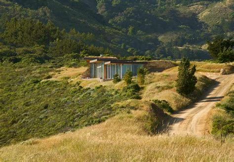 homes built into hillside green roofed ridge house is tucked into the hillside