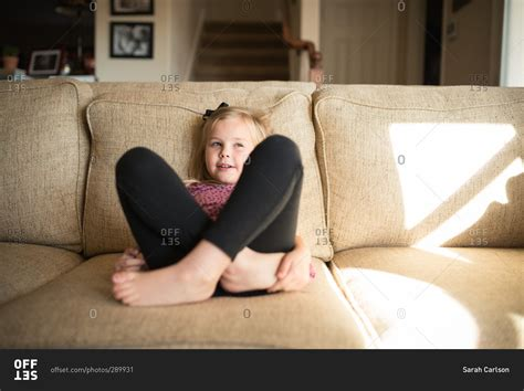 little girls legs little girl sitting on a couch with her legs crossed and