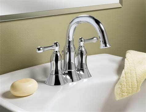 stainless steel center set bathroom faucets mounted on a