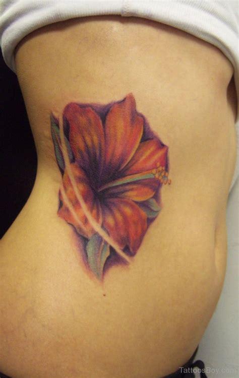 Hibiscus Tattoos Tattoo Designs Tattoo Pictures Flower Rib Tattoos