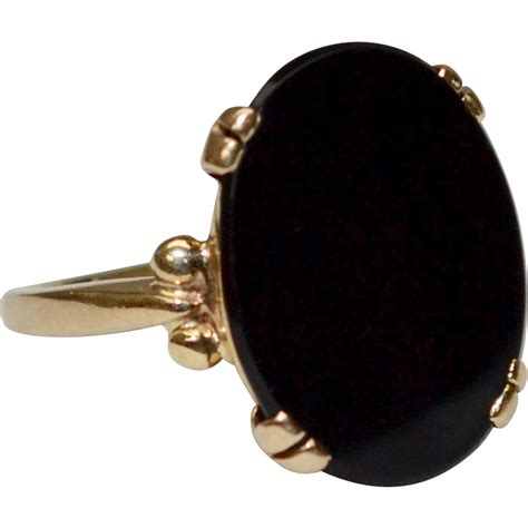 14k gold oval black onyx ring from blackwidowvintiques on