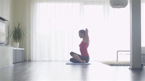 living room yoga young woman doing yoga at living room at home by