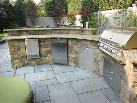 custom bi level radial outdoor kitchen bar veneered with