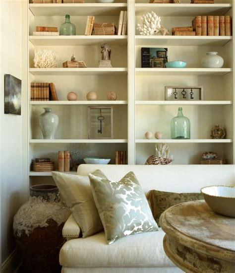 how to decorate a shelf in living room the iron gate chic small living room with wall of white built ins white sofa with