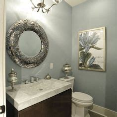 traditional brown and gold guest bathroom with oval mirror bathroom ideas colors on pinterest bathroom sink vanity
