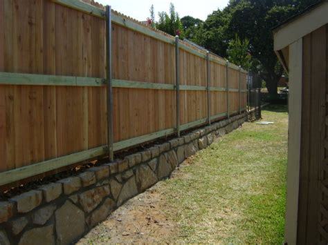 cedar privacy fence on stone retaining wall dallas by circle d industries