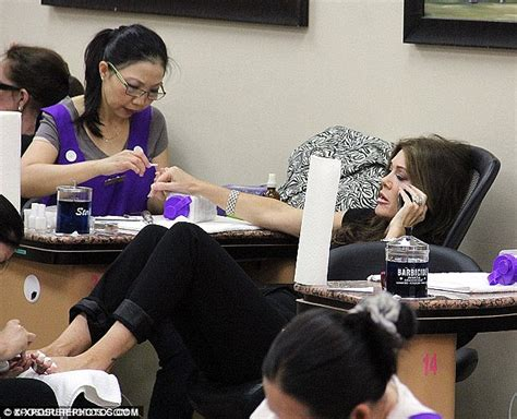 emmy rossum shares a laugh with her manicurist at the nail