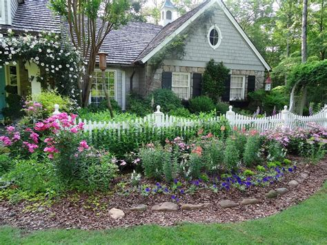 cottage garden fencing a white picket fence adds to the sweet setting of an