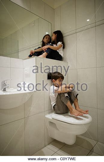 boy and girl in the bathroom girl toilet sitting stock photos girl toilet sitting